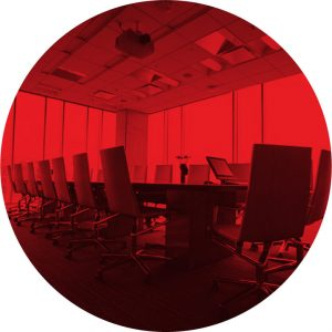 red overlay circle image of conference room